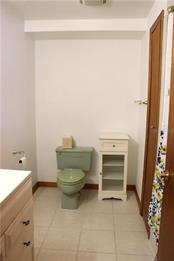 Large guest bath has a linen closet and a vintage green potty! - Single Family Home for sale at 2220 Pine Ter, Sarasota, FL 34231 - MLS Number is A4440562