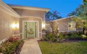 CHARMING & INVITING...ON A VERY PRIVATE ROAD WITH JUST A FEW NEIGHBORS - Single Family Home for sale at 3 Winslow Pl, Longboat Key, FL 34228 - MLS Number is A4464990