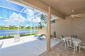 Tile and concrete pad. - Villa for sale at 4590 Samoset Dr, Sarasota, FL 34241 - MLS Number is A4471881