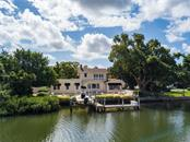 130 Feet of Frontage on the Hudson Bayou - Single Family Home for sale at 1595 Bay Point Dr, Sarasota, FL 34236 - MLS Number is A4479218