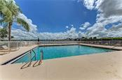 Community pool with stunning pond views - Single Family Home for sale at 7118 68th Dr E, Bradenton, FL 34203 - MLS Number is A4480398
