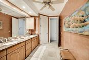 A private water closet & double sinks with wonderful cabinetry space - Single Family Home for sale at 501 Cutter Ln, Longboat Key, FL 34228 - MLS Number is A4480484