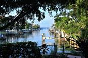 The flora & fauna welcome all your friendly birds to fish at your dock ! - Single Family Home for sale at 501 Cutter Ln, Longboat Key, FL 34228 - MLS Number is A4480484