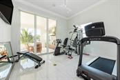 Exercise Room Off Pool Deck Near Outdoor Grill and Dinning Area - Single Family Home for sale at 121 Seagull Ln, Sarasota, FL 34236 - MLS Number is A4483951