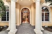 A grand entryway with classical mediterranean architecture throughout. - Single Family Home for sale at 8263 Archers Ct, Sarasota, FL 34240 - MLS Number is A4483993
