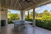 The outdoor ping pong table at the River Lodge. - Single Family Home for sale at 11720 Rive Isle Run, Parrish, FL 34219 - MLS Number is A4486302