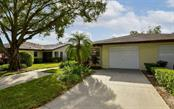 Attached garage with driveway space & extra parking pad to the left. - Villa for sale at 3314 Vivienda Blvd, Bradenton, FL 34207 - MLS Number is A4488348