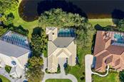 Aerial view showing off the additions on the back and front of the home, along with the new roof (2017) - Single Family Home for sale at 7879 Estancia Way, Sarasota, FL 34238 - MLS Number is A4490318