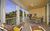 Screened balcony with hurricane shutters - Condo for sale at 409 N Point Rd #402, Osprey, FL 34229 - MLS Number is A4491620