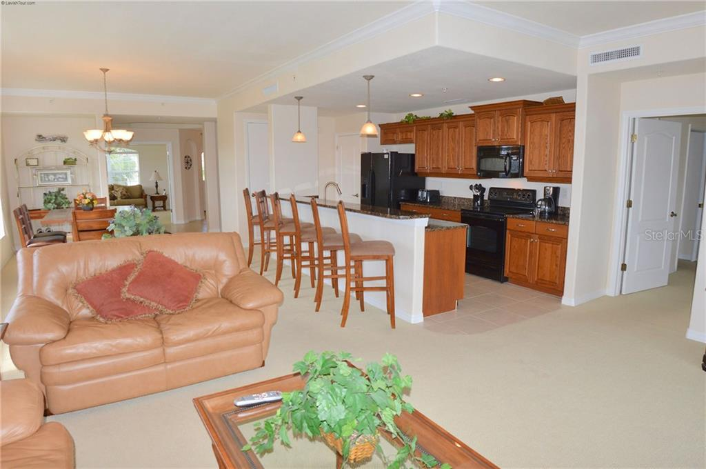 Living Room/Kitchen/Dining Room - Condo for sale at 1100 San Lino Cir #1134, Venice, FL 34292 - MLS Number is N5910364