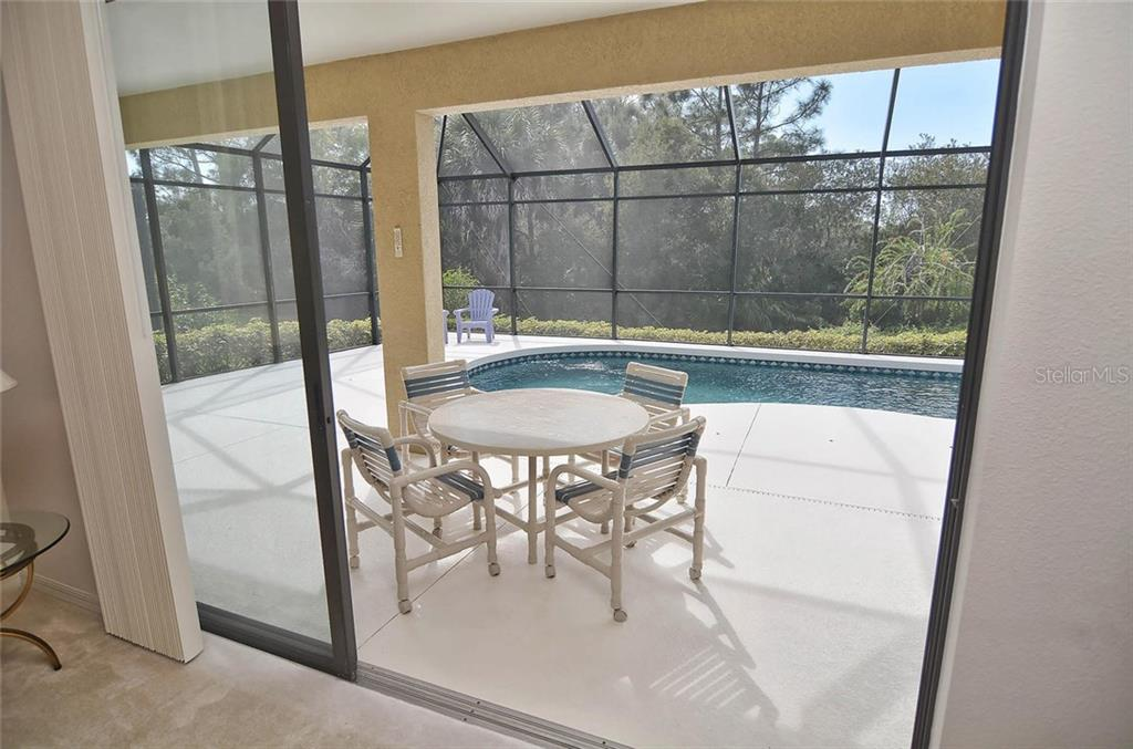 Lanai and pool from living room. - Single Family Home for sale at 1975 Batello Dr, Venice, FL 34292 - MLS Number is N5911919