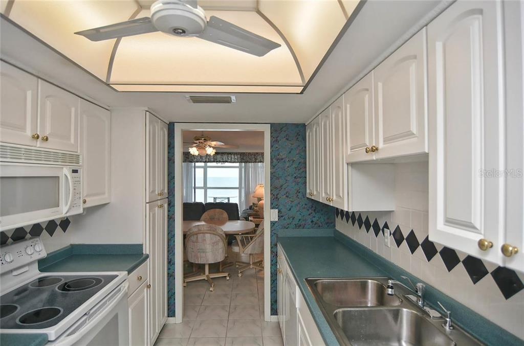 Kitchen to dining room - Condo for sale at 255 The Esplanade N #805, Venice, FL 34285 - MLS Number is N5912261