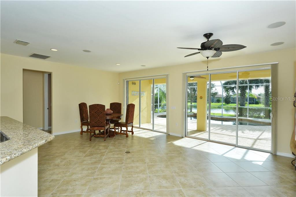 Great room to pool - Single Family Home for sale at 19168 Jalisca St, Venice, FL 34293 - MLS Number is N5912651