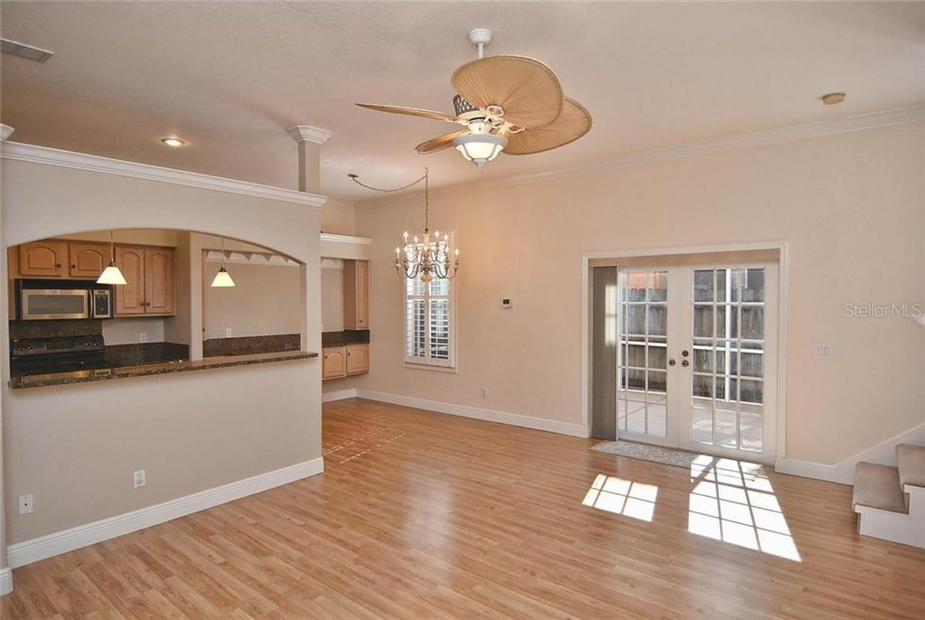 Living room, dining room, kitchen - Condo for sale at 501 Barcelona Ave #c, Venice, FL 34285 - MLS Number is N5913183