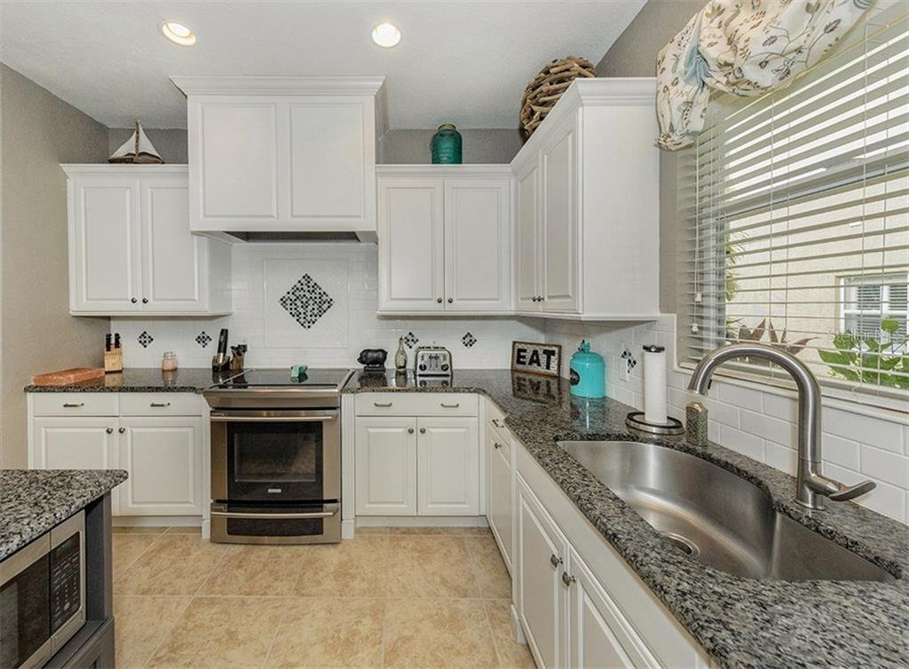 Kitchen - Single Family Home for sale at 11759 Puma Path, Venice, FL 34292 - MLS Number is N5913611