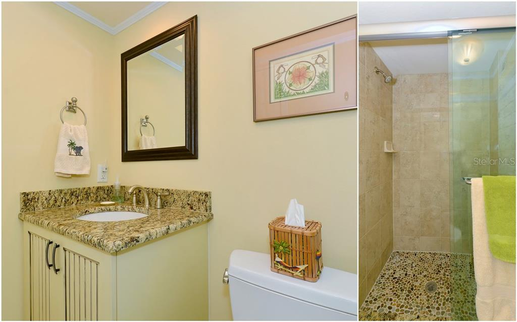 Master bath with duel sinks in granite, Amish cabinets and walk-in shower with tile detail - Single Family Home for sale at 255 The Esplanade N #706, Venice, FL 34285 - MLS Number is N5913875