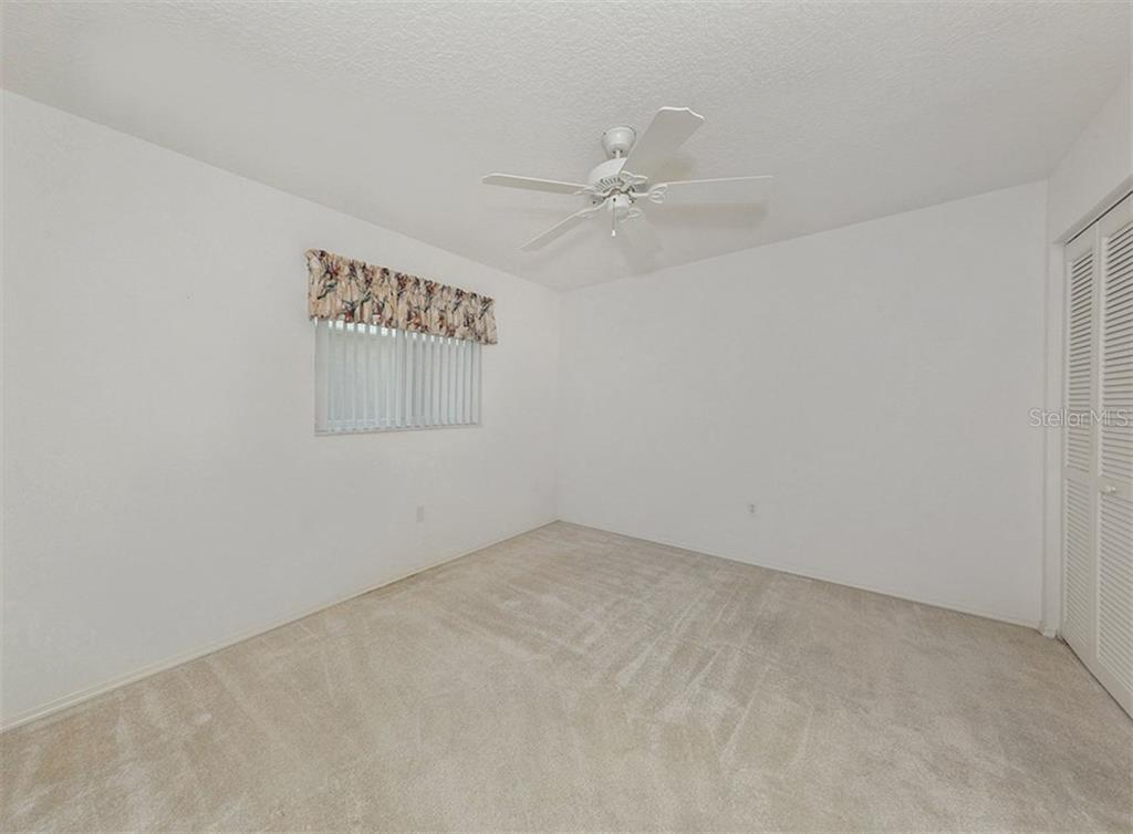 Bedroom 3 - Single Family Home for sale at 683 May Apple Way, Venice, FL 34293 - MLS Number is N5913909