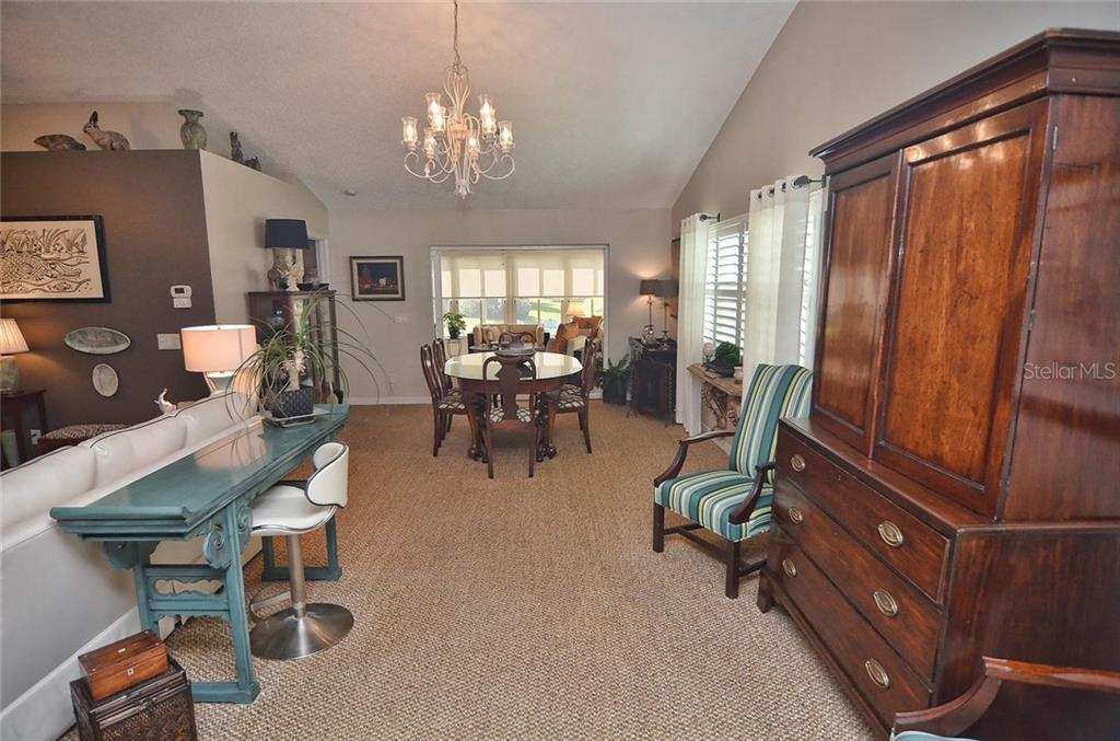 Living/dining room - Single Family Home for sale at 1812 Ashley Dr, Venice, FL 34292 - MLS Number is N5914047