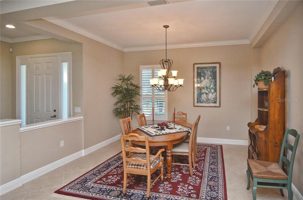 Dining room to foyer - Single Family Home for sale at 293 Marsh Creek Rd, Venice, FL 34292 - MLS Number is N5914238