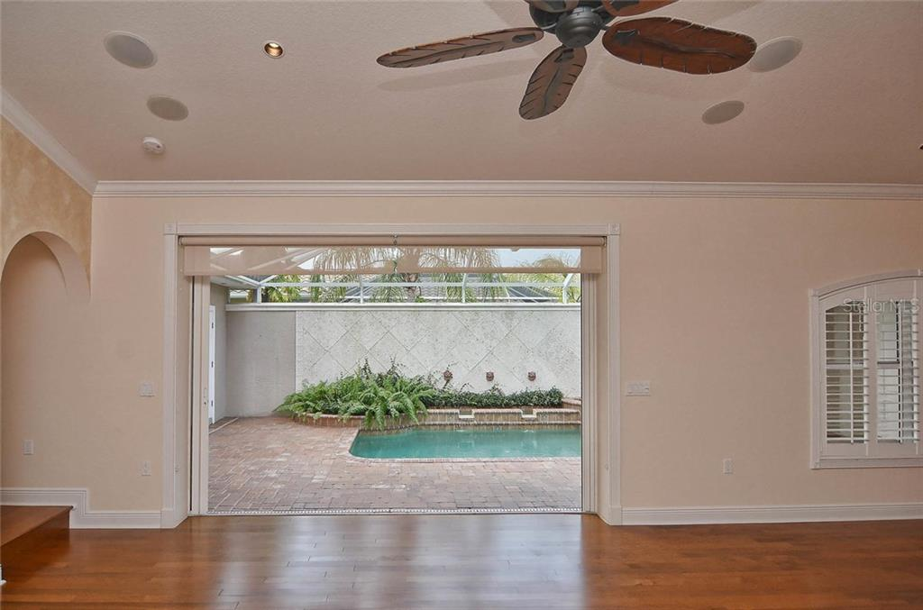 Living room to pool - Single Family Home for sale at 248 Pensacola Rd, Venice, FL 34285 - MLS Number is N5914299