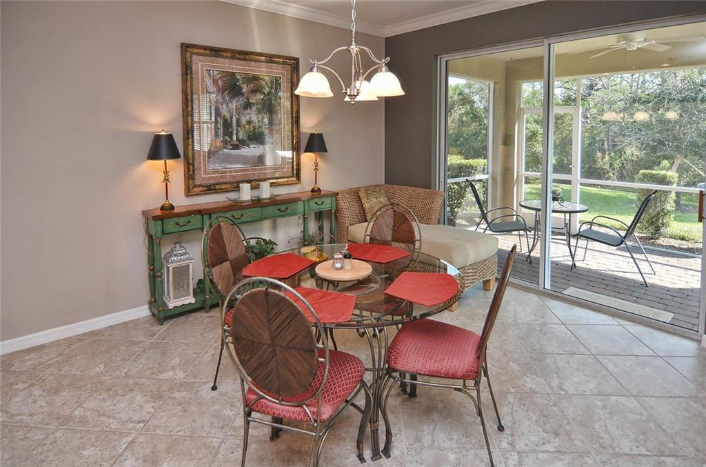 Dinette to lanai - Single Family Home for sale at 9124 Coachman Dr, Venice, FL 34293 - MLS Number is N5914408