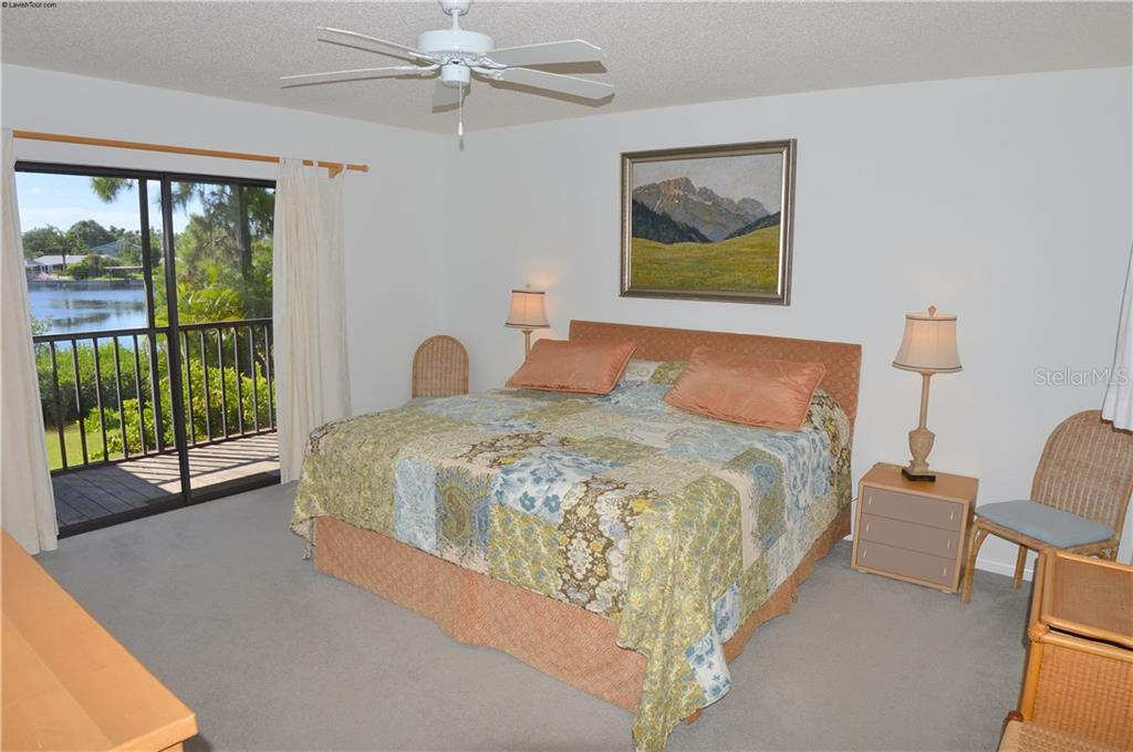Bedroom with sliders to lanai - Single Family Home for sale at 1649 Manor Rd, Englewood, FL 34223 - MLS Number is N5914466