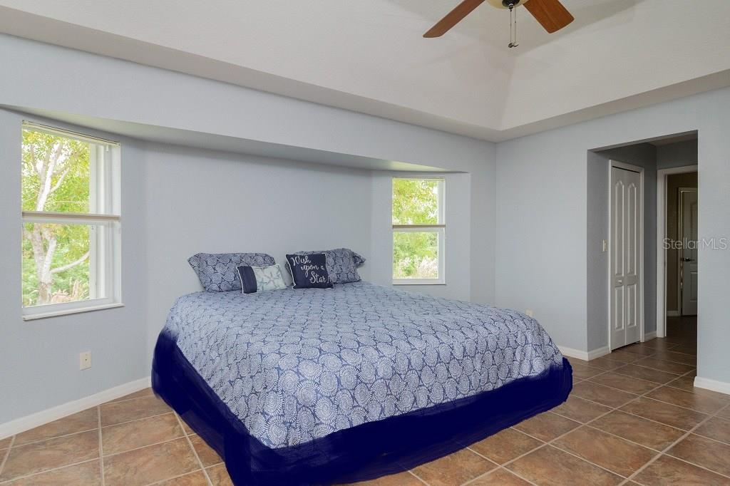 Master Bedroom looking to the 2 Walk-in Closets one on either side then continuing into the Master Bath. Tile floors throughout and Designer touches at every turn - Single Family Home for sale at 5149 Latham Ter, Port Charlotte, FL 33981 - MLS Number is N5914515
