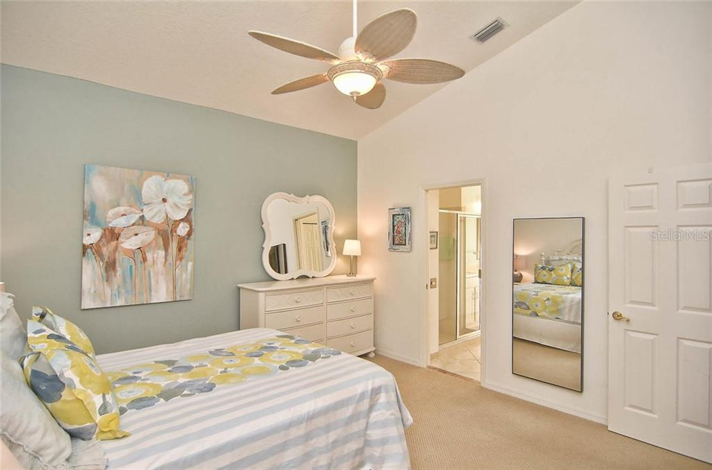 Master bedroom to master bath. - Single Family Home for sale at 498 Meadow Sweet Cir, Osprey, FL 34229 - MLS Number is N5914789