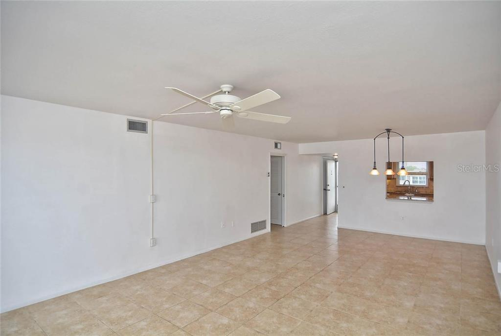 Living room to dining room and foyer. Pass through from dining room to kitchen. - Condo for sale at 333 The Esplanade N #402, Venice, FL 34285 - MLS Number is N5914981