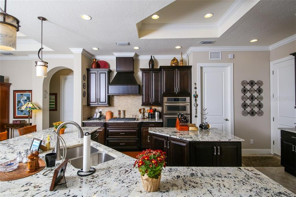 Casual Dining area is  part of the kitchen/family room. - Single Family Home for sale at 190 Portofino Dr, North Venice, FL 34275 - MLS Number is N5915077