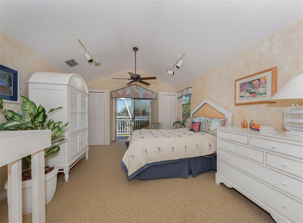 2nd guest bedroom also offering balcony with views of the bay. - Single Family Home for sale at 3509 Casey Key Rd, Nokomis, FL 34275 - MLS Number is N5915098