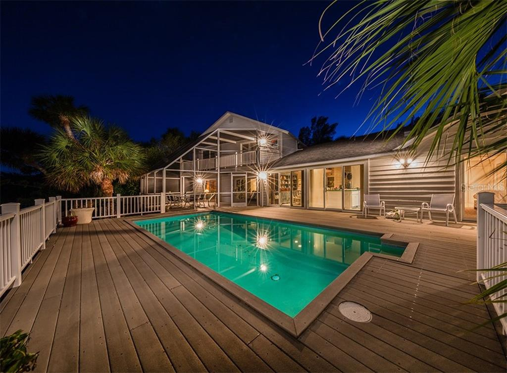 Twilight view of huge deck and pool - Single Family Home for sale at 3509 Casey Key Rd, Nokomis, FL 34275 - MLS Number is N5915098