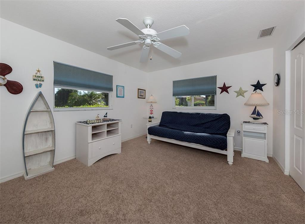 Bedroom 3 - Single Family Home for sale at 866 Wood Sorrel Ln, Venice, FL 34293 - MLS Number is N5915362