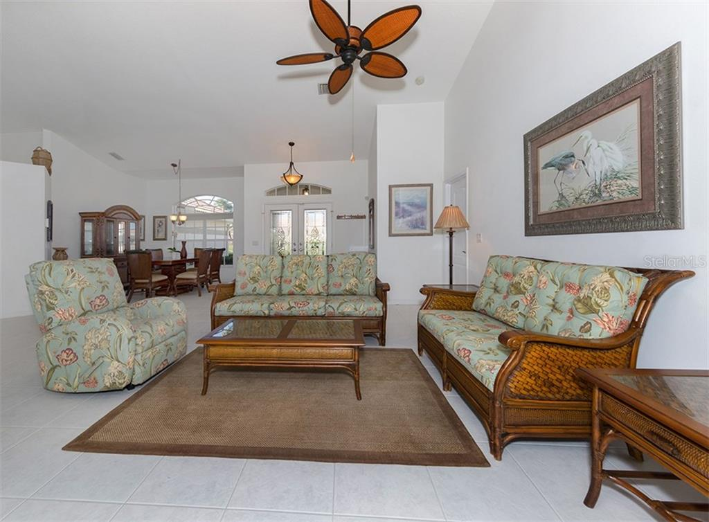 Living room to foyer and dining room - Single Family Home for sale at 866 Wood Sorrel Ln, Venice, FL 34293 - MLS Number is N5915362