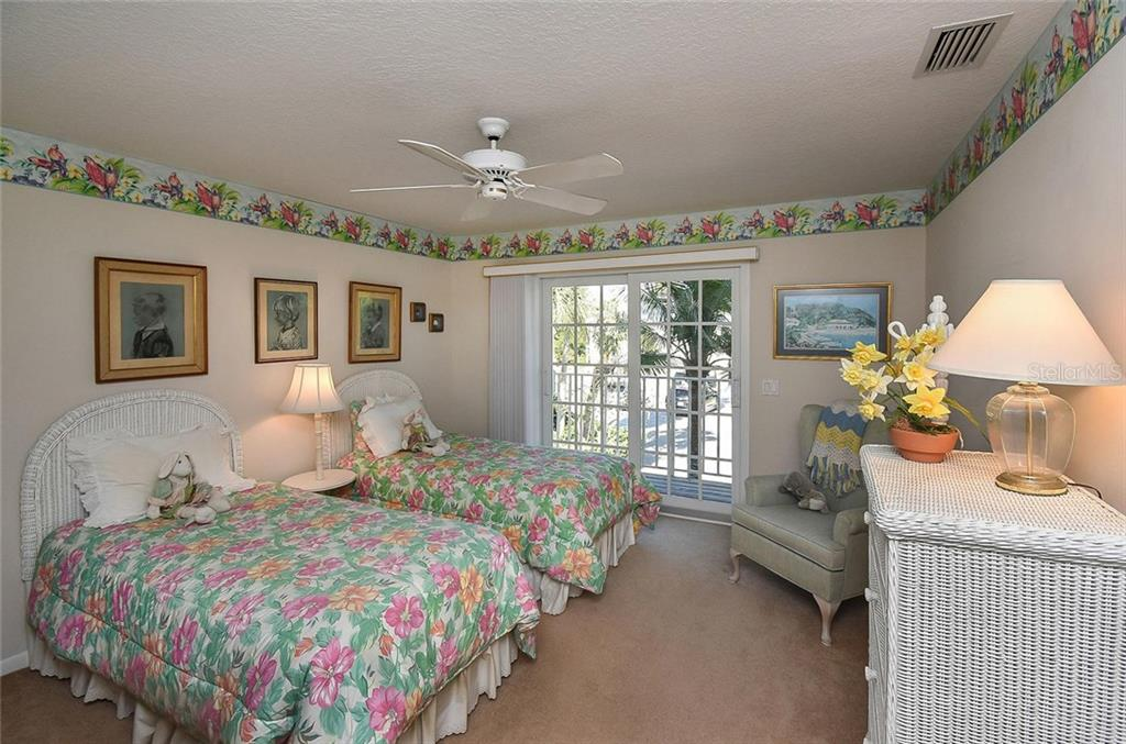 Bedroom 2 - Single Family Home for sale at 910 Casey Cove Dr, Nokomis, FL 34275 - MLS Number is N5915385
