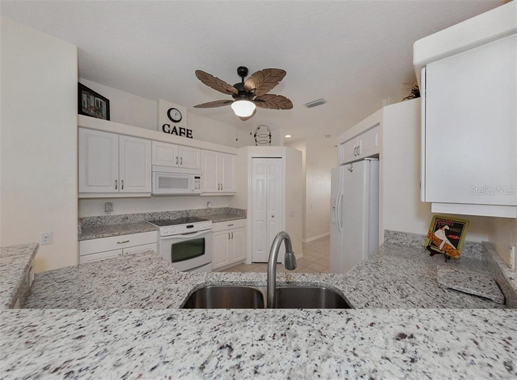 Kitchen - Single Family Home for sale at 2196 Calusa Lakes Blvd, Nokomis, FL 34275 - MLS Number is N5915879