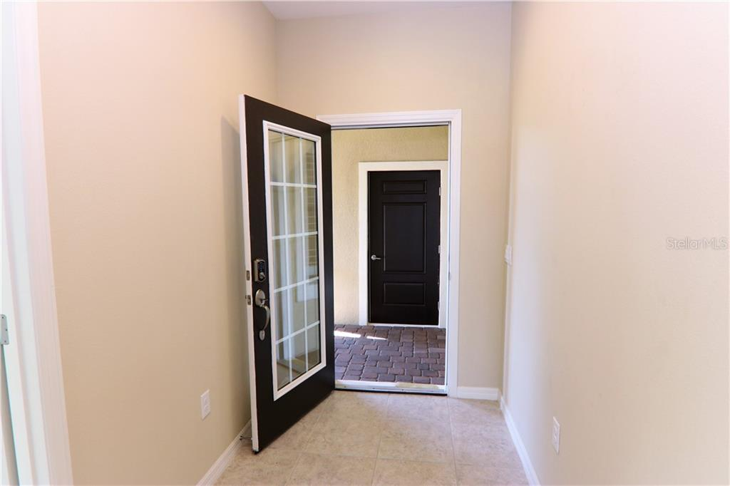 Hall Bath With Tub Shower And Linen Closet - Villa for sale at 10731 Trophy Dr, Englewood, FL 34223 - MLS Number is N6100149