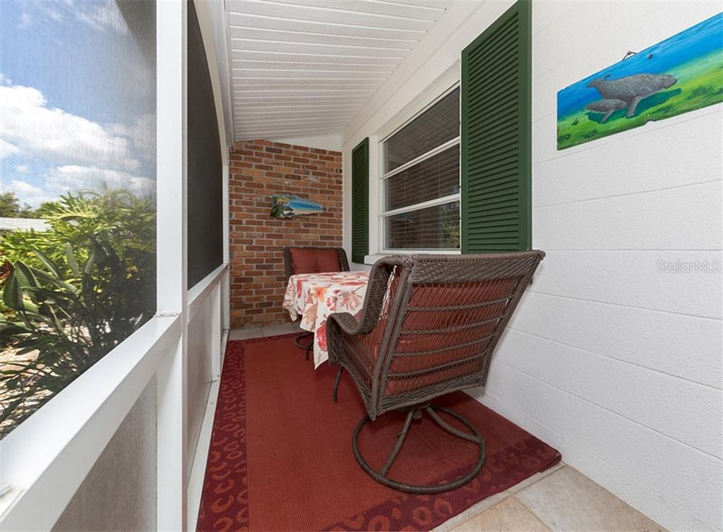 Plenty of space on your 37' screened front porch for dining, seating and storage space. - Condo for sale at 100 The Esplanade N #4, Venice, FL 34285 - MLS Number is N6100334