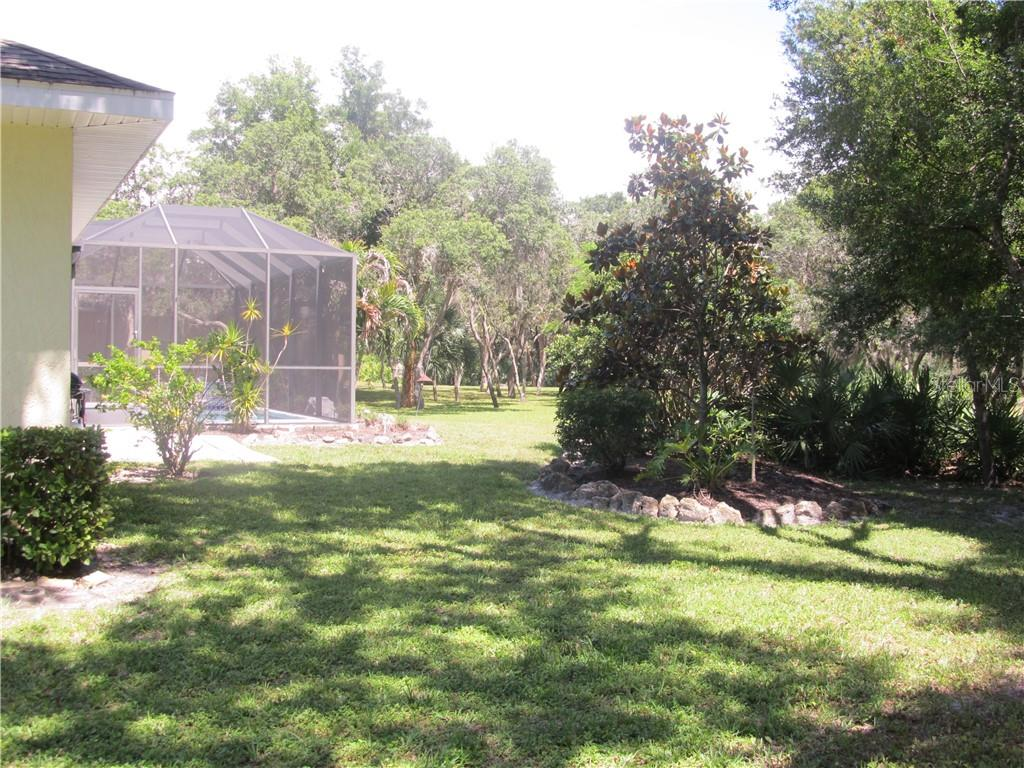 Lush, private with lots of elbow room - Single Family Home for sale at 2405 Uppakrik Ln, Nokomis, FL 34275 - MLS Number is N6100812