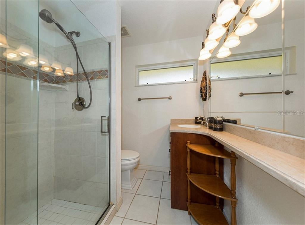 En-suite bath with large walk in shower. - Single Family Home for sale at 620 Valencia Rd, Venice, FL 34285 - MLS Number is N6100912