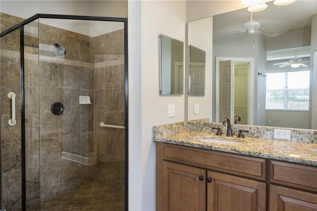 Master Bath with Granite Counters & Glass Shower - Single Family Home for sale at 2290 Terracina Dr, Venice, FL 34292 - MLS Number is N6101301