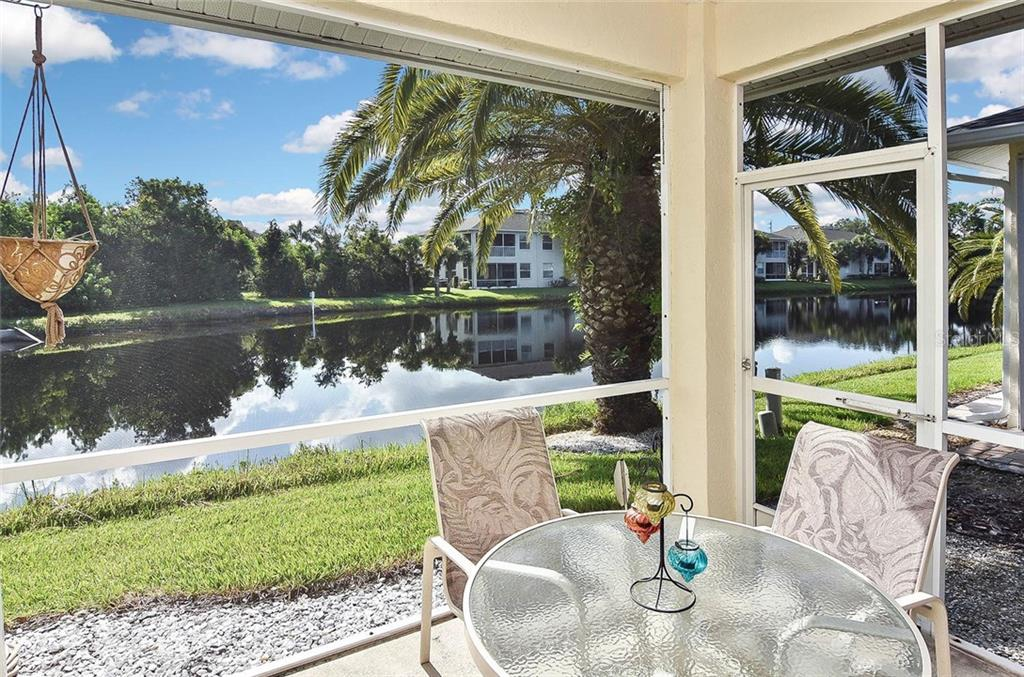 Screened lanai with water view - Villa for sale at 1720 Fountain View Cir, Venice, FL 34292 - MLS Number is N6101363