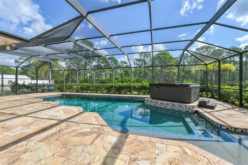 Pool/spa - Single Family Home for sale at 9150 Deer Ct, Venice, FL 34293 - MLS Number is N6101408