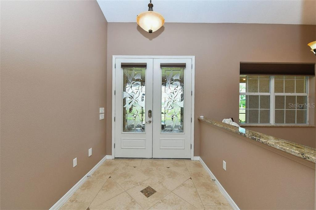 Foyer - Single Family Home for sale at 9150 Deer Ct, Venice, FL 34293 - MLS Number is N6101408
