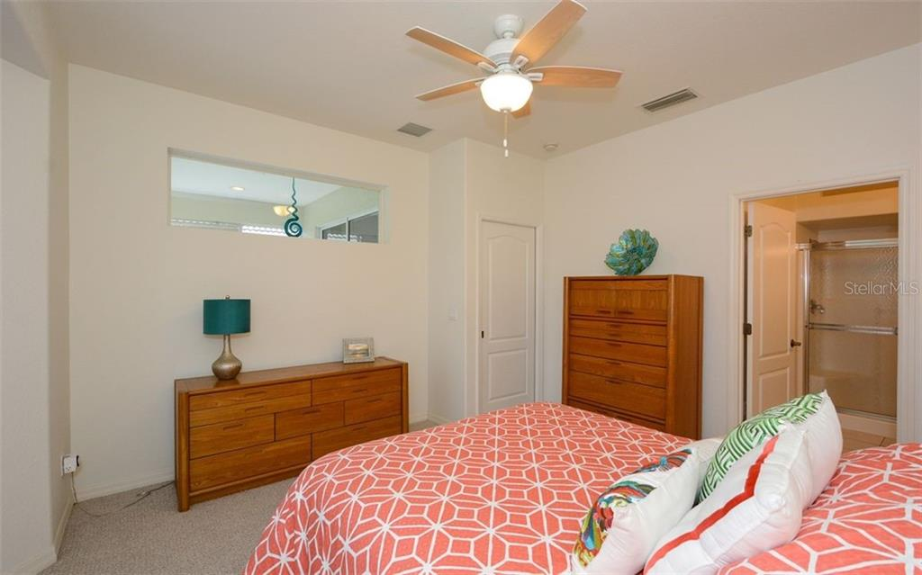 Master bedroom to master bath - Villa for sale at 313 Auburn Woods Cir, Venice, FL 34292 - MLS Number is N6101432