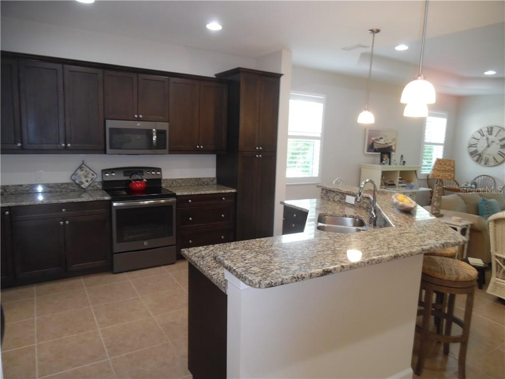 kitchen opens to the living room - Single Family Home for sale at 239 Nolen Dr, Venice, FL 34292 - MLS Number is N6101457