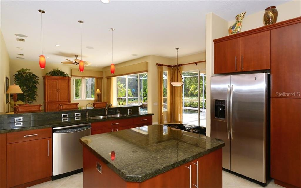 Kitchen to family room - Single Family Home for sale at 913 Chickadee Dr, Venice, FL 34285 - MLS Number is N6101770