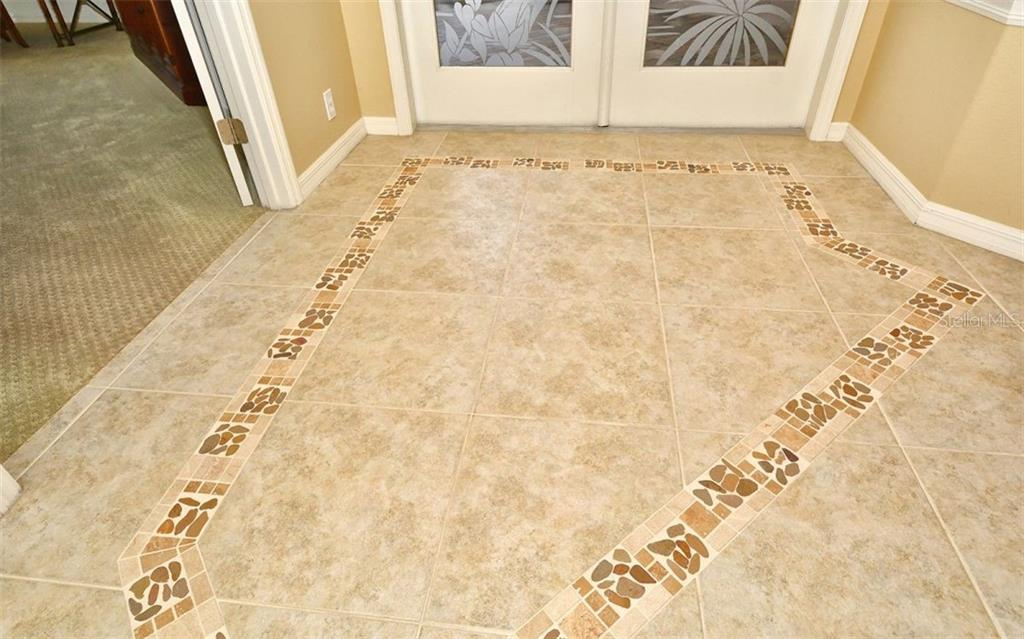 Tile in foyer - Single Family Home for sale at 913 Chickadee Dr, Venice, FL 34285 - MLS Number is N6101770