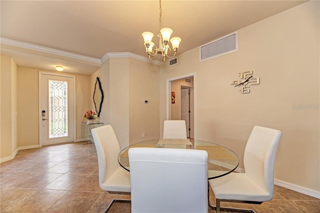 Dining to front door. - Condo for sale at 20200 Ragazza Cir #102, Venice, FL 34293 - MLS Number is N6101798