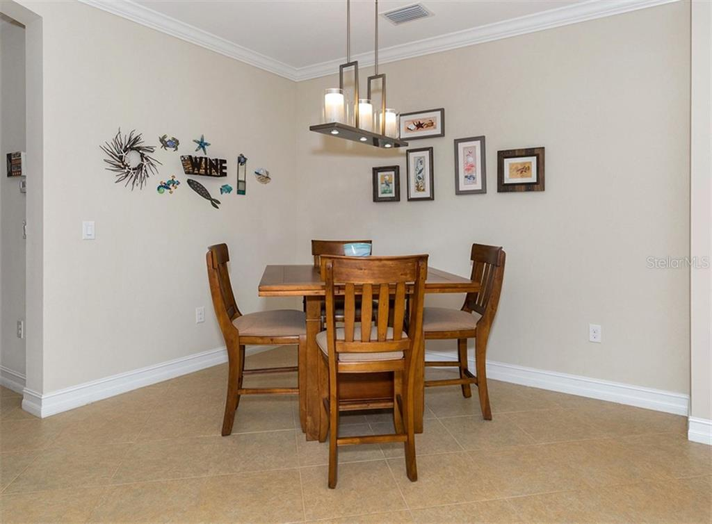 Dining room - Single Family Home for sale at 646 Resolute St, Nokomis, FL 34275 - MLS Number is N6102035